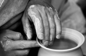 What is an Artisan - Potter working clay
