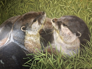 A pair of otters painting